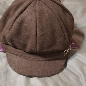 Gently worn.  Brown Wool Cabbie Hat.